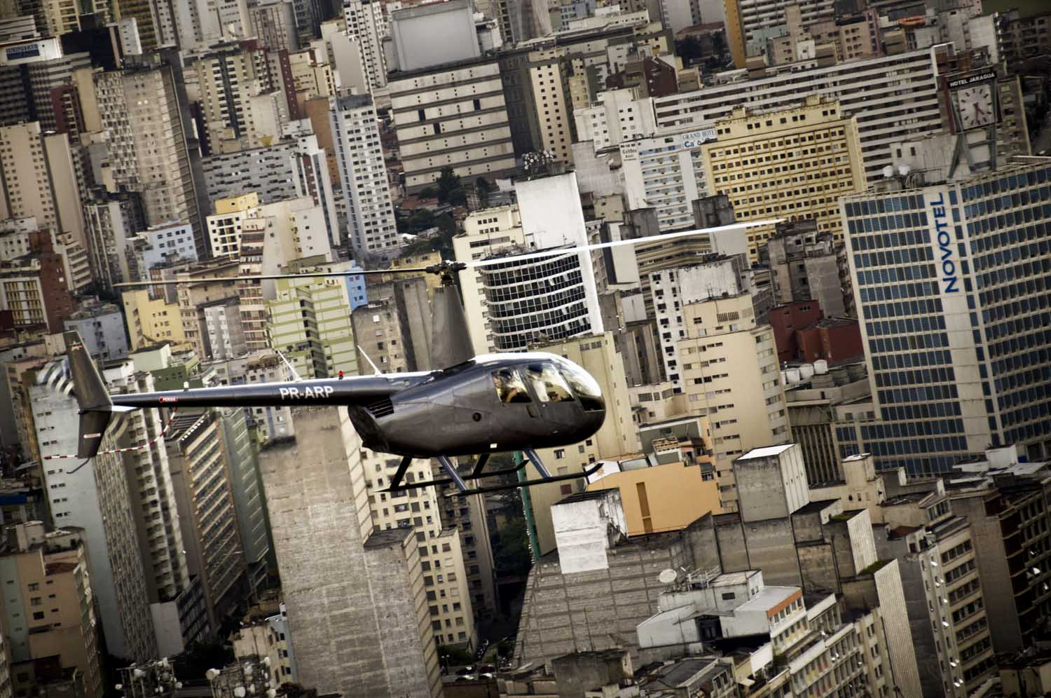 Helicopter overflies downtown Sao Paulo - Sao Paulo has the second worlds helicopters fleet.