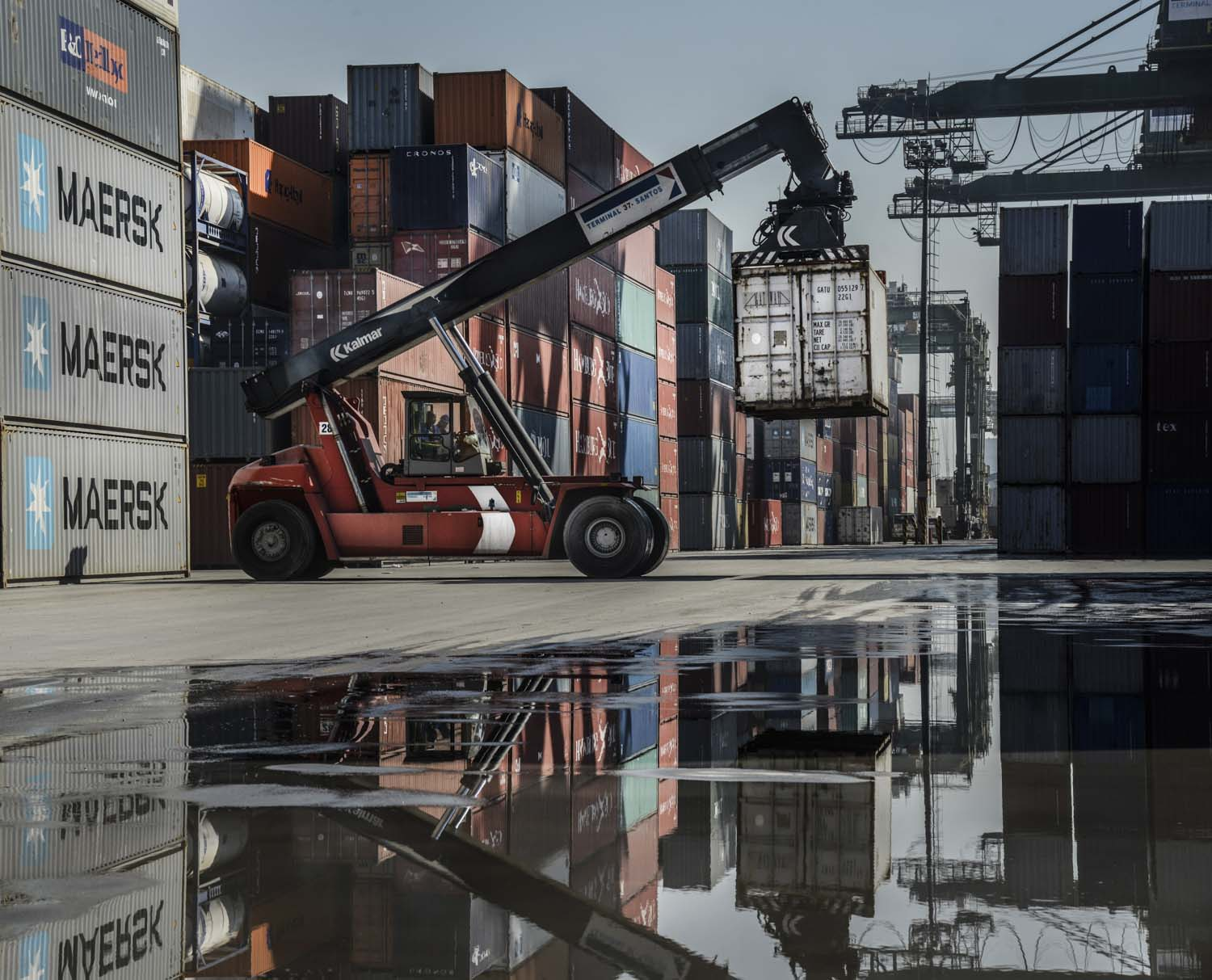 Container is picked up to be loaded into a truck at Libra Terminal, Santos Port, Brazil. For Bloomberg USA.