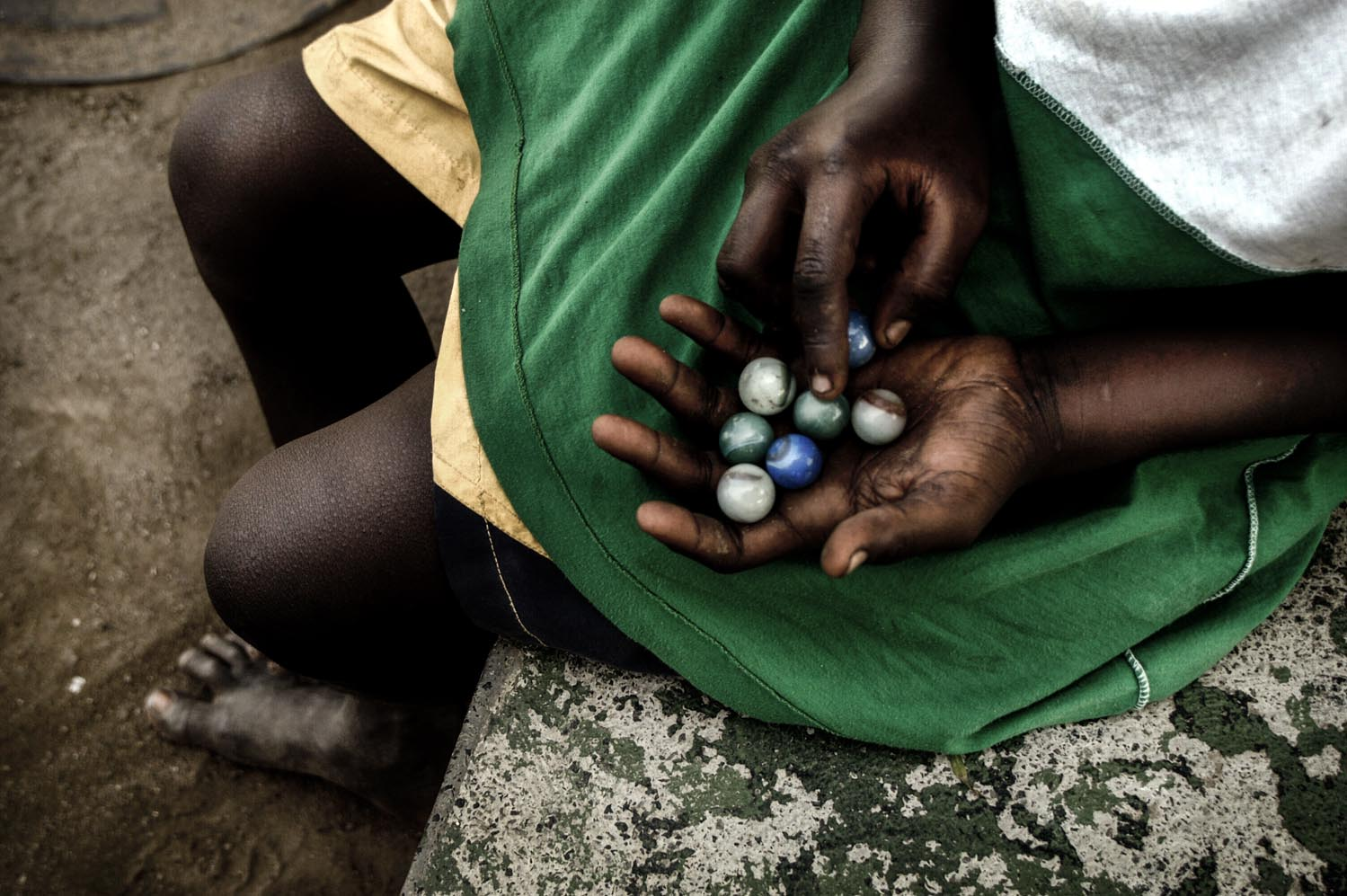 Boy holds marble balls at Flamengo's park in the City of Rio de Janeiro, Brazil.