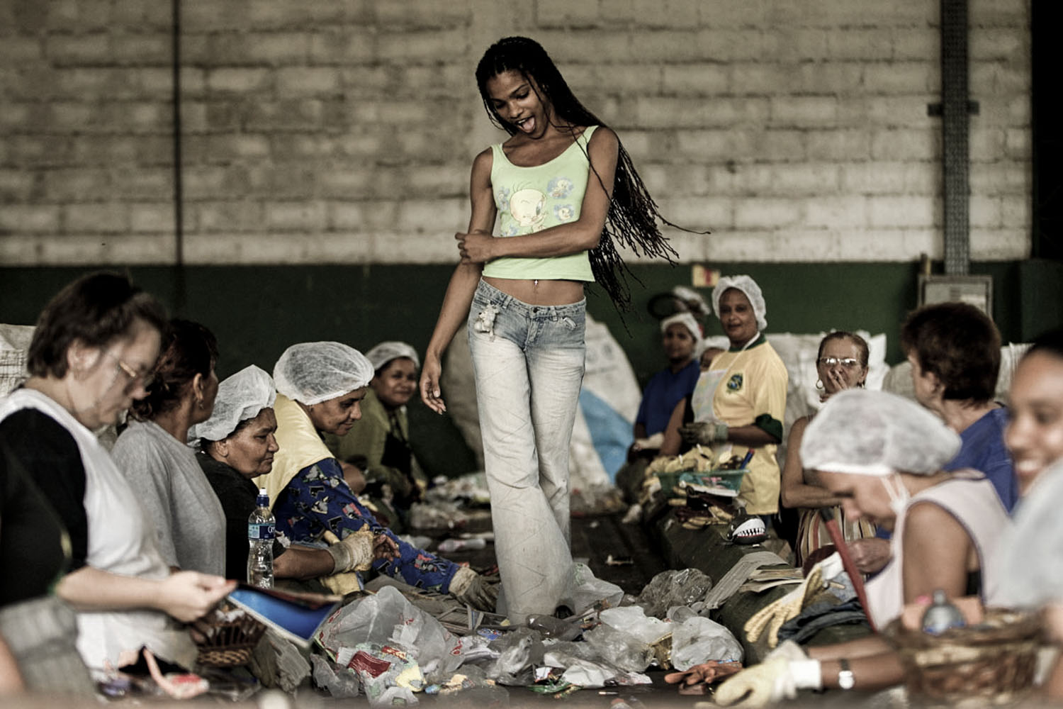 Worker plays parading at a Recycling Place in the suburbs of Sao Paulo.
