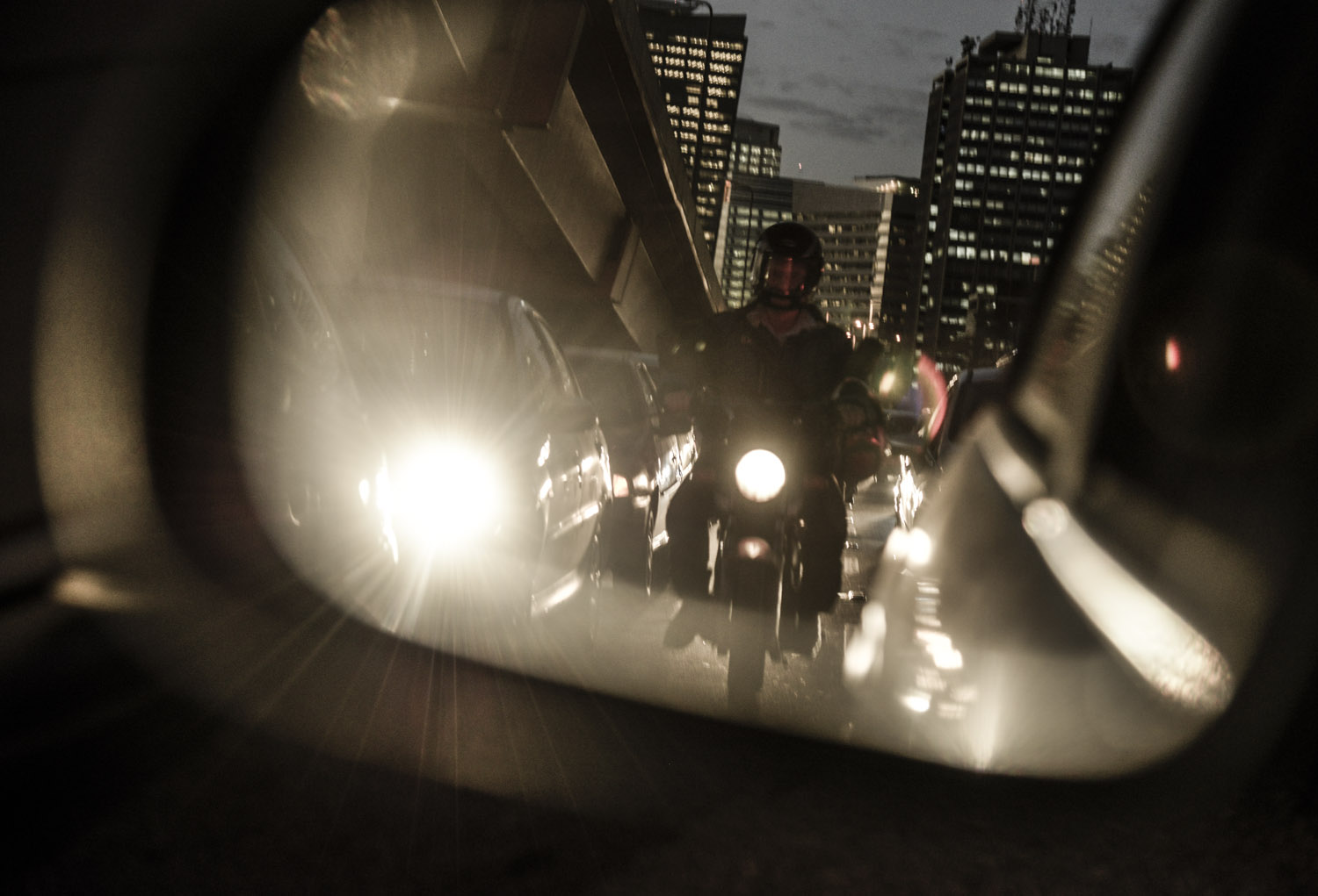 A motorcycle in a traffic jam in the new business district of Berrini, Sao Paulo.