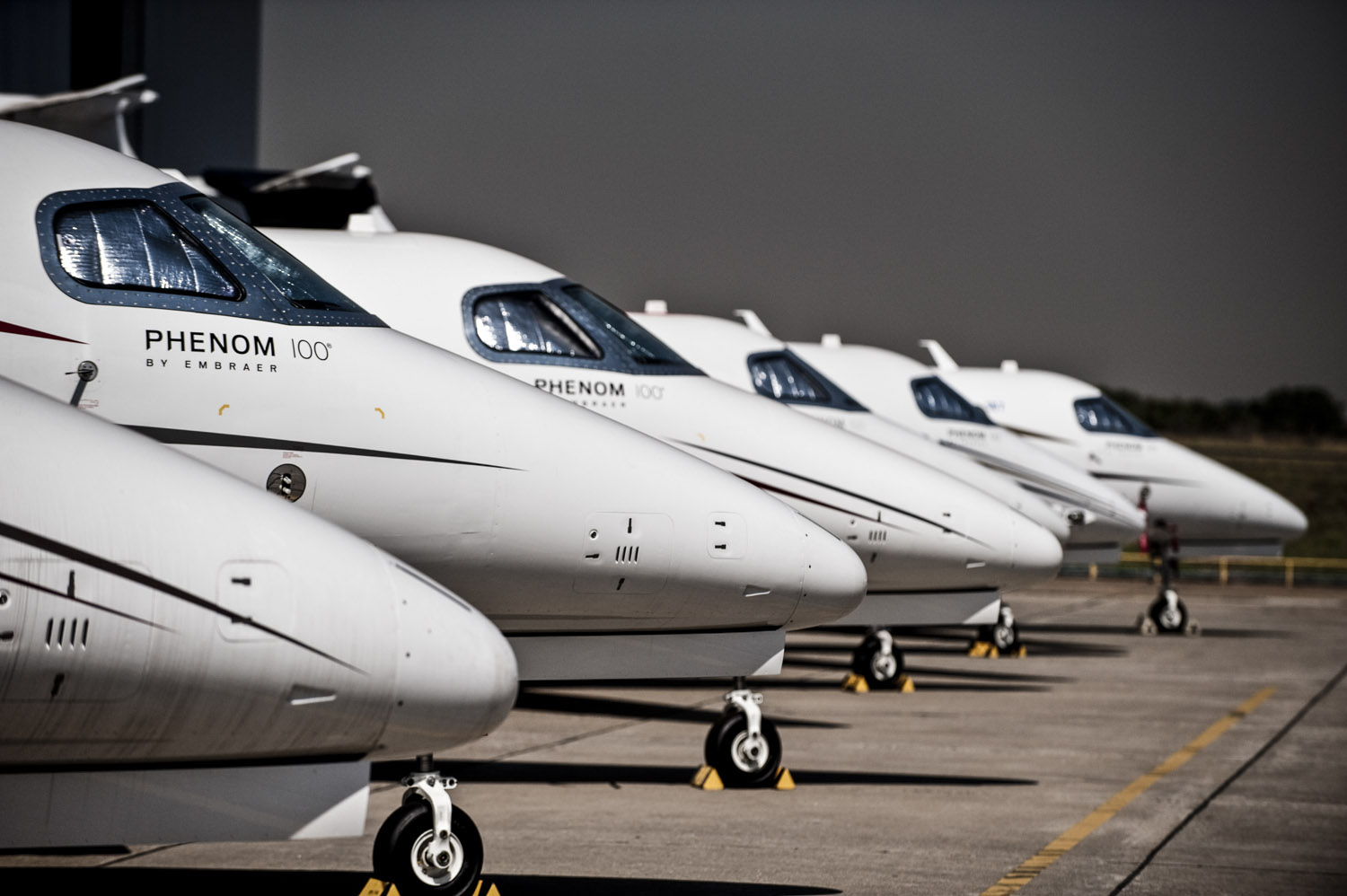 Embraer Phenom Airplanes sit at the plant, Embraer's Anual Report.