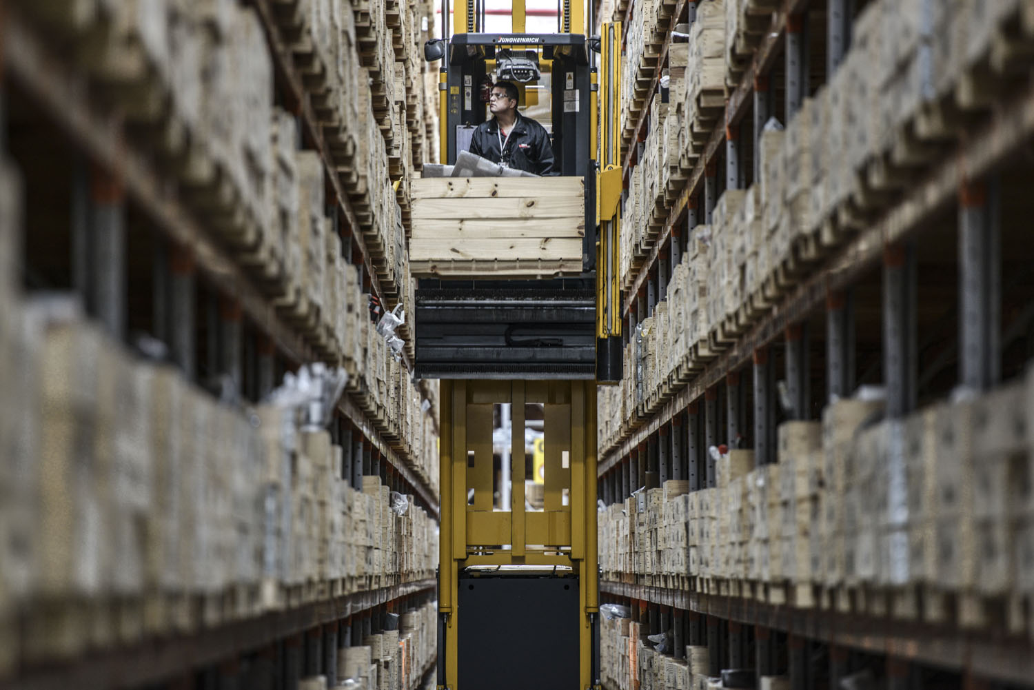 Employee looks for a part at the CASE's distribution center line, Sorocaba  Brazil.